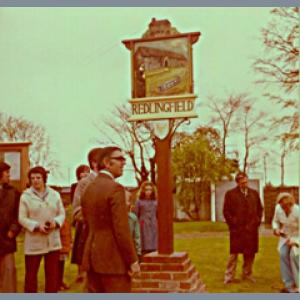 Unveiling village sign